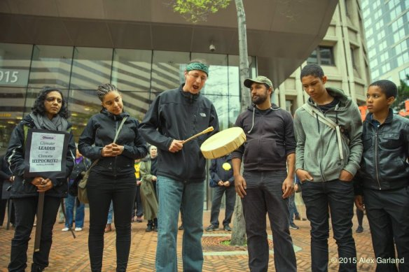 Matt Remle (Lakota - center) with Aji Piper (5th left to right). At climate justice rally at Seattle Federal building.
