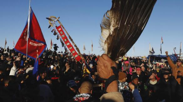 "Native American ""water protectors"" celebrate that the Army Corps of Engineers has denied an easement for the $3.8 billion Dakota Access Pipeline inside of the Oceti Sakowin camp as demonstrations continue against plans to pass the Dakota Access pipeline near the Standing Rock Indian Reservation, near Cannon Ball, North Dakota, U.S., December 4, 2016. REUTERS/Lucas Jackson"