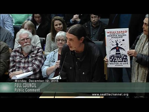 Matt Remle (Lakota) gives testimony at the Seattle City Council meeting to divest from Wells Fargo.