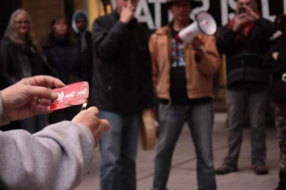 Long time Wells Fargo member burns bank card after closing account in Seattle.