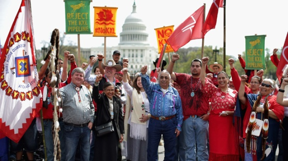 "WASHINGTON, DC - APRIL 22: Members of the Cowboy and Indian Alliance, including Native Americans, farmers and ranchers from across the United States, begin a demonstration against the proposed Keystone XL pipeline in front of the U.S. Capitol April 22, 2014 in Washington, DC. As part of its ""Reject and Protect"" protest, the Cowboy and Indian Alliance is organizing a weeklong series of actions by farmers, ranchers and tribes to show their opposition to the pipeline. (Photo by Chip Somodevilla/Getty Images)"